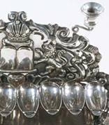 <p>Hanukkah lamp, Lodz, Poland, ca. 1835</p><p>Silver</p><p>National Museum of American Jewish History, 1987.10.2 a-c</p><br /><span></span>